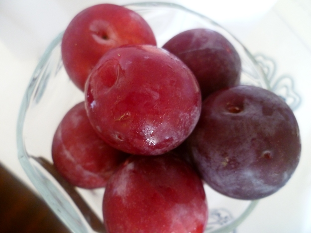 A Vase of Plums